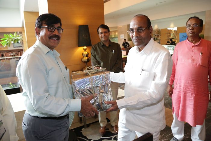 CMD presenting a token gift to the Minister
